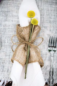 Wrapping a stiff white napkin in burlap gives a rustic look. Via Tracy Autem Photography. #napkins