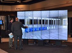 A large video wall was used to demonstrate IO's data center management software, called IO.OS. (Photo: Colleen Miller)
