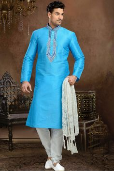 This Kurta Pajama Is Perfect One Crafted With Embroidery Work. The Sky Blue Colour Kurta Is Fabricated In Dhupion Fabric. It Has Comes In Various Sizes 36,38,40,42,44 So You Can Wear This And Make You...