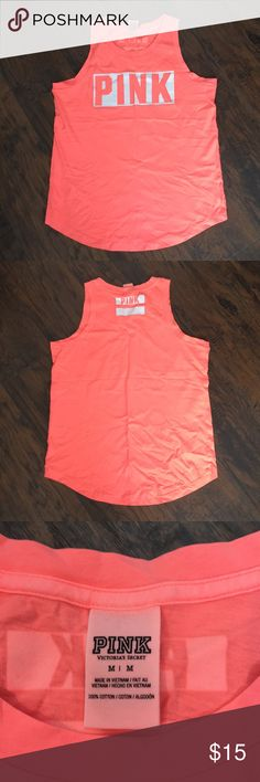 NWOT VS PINK Workout Tank - M New without tags Victoria's Secret PINK workout tank, size medium. This tank looks coralish pink in the photos, but in reality it is bright NEON ORANGE/PINK, which is why I never wore it. Still very cute, just not quite my style. PINK Victoria's Secret Tops