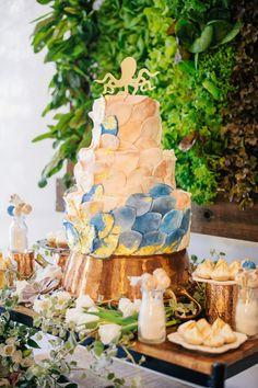 wedding cake with petals, photo by Angel He Photography http://ruffledblog.com/tampa-modern-wedding-ideas #weddingcake #cakes