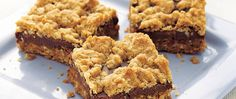 Betty Crocker's Heart Healthy Cookbook shares a recipe! Enjoy these layered chewy bars that are baked using whole cereals and chocolate. Perfect for an anytime dessert.