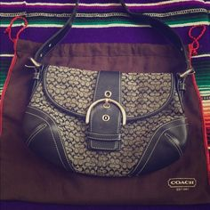 Coach purse Small Coach purse. Black and gray. Gently used. Make me an offer Coach Bags Mini Bags