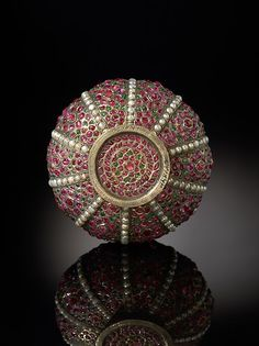 Rosewater Sprinkler (gulabpash) Date: 17th century (base), late 18th century (neck) Geography: North India Medium: Metal, inlaid with rubies, emeralds, and pearls Dimensions: H: 10 1/8 in. (25.5 cm) Classification: Metalwork-Jewelry Credit Line: The Al-Thani Collection