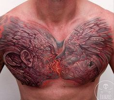 Such a creative chest piece. Tattoo by Boris
