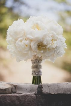 white peonies for bridesmaids with some bling of course