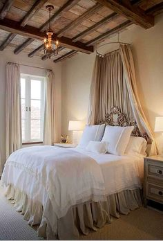 love the combination of the rustic wood and the soft white linens