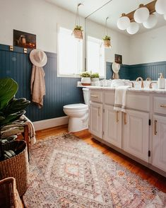 A throwback to when Trav and I transformed my mom's 1989 powder room into a refined and modern rustic respite...all in SEVEN days. We put up headboard, painted everything and refinished the cabinetry and vanity; even switched out the electrical and plumbing. Will we never forget that Christmas in Seattle, NOPE! Diy Bathroom Paint, Teal Bathroom Decor, Diy Bathroom Remodel, Bathroom Renovations, Modern Bathroom, Bathroom Interior, Bathroom Beadboard, Silver Bathroom, White Bathrooms
