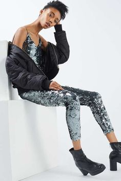 d5162f3bba8 Form fitting jumpsuit with sequins all over. Features adjustable straps and  chunky exposed zip. topshop.com