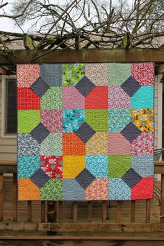 I am so excited because today I finally get to show off this beautiful quilt I made using the Fat Quarter Shop's free Layers of Charm Pattern. When the Fat Quarter Shop contacted me to see if I wa