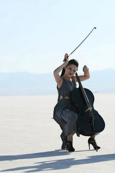 Cello - Tina Guo... Apparently, it's a cellist thing! Two of my best friends who are cellists like me do this ALL the time!