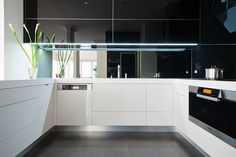 "Good lighting can totally transform your kitchen area.  Great lighting can take it to the next level. LED strip lighting is used here with high gloss, mirror finish doors from ALBEDOR'S ""True Reflections"" range and the results are spectacular. For more info on our range of high gloss finishes visit our website www.albedor.com.au Strip Lighting, Cool Lighting, Roller Doors, Built In Furniture, Decorative Panels, Mirror Door, Panel Doors, Kitchen Cabinets, It Is Finished"