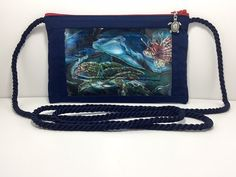 As we go about our hectic lives, take along this Underwater Text and Tote™ phone wristlet to help you day dream about snorkeling to see all of these majestic creatures! Unless, of course, you are like me and would rather admire them from afar :)
