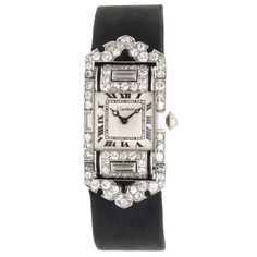 Art Deco Cartier Lady's Diamond Onyx Platinum Wristwatch | From a unique collection of vintage wrist watches at https://www.1stdibs.com/jewelry/watches/wrist-watches/