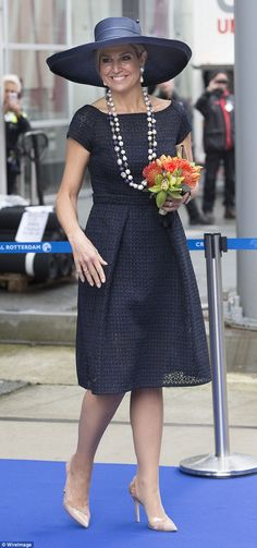 Earlier, Maxima attended a dedication ceremony for a cruise ship in a navy A-line midi dre...