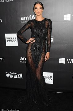 Gothic chic: Alessandra Ambrosio donned an exquisite black gown at the amfAR Inspiration G...