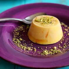 Mango kulfi is a traditional deliciously rich frozen dessert from India, that is typically garnished with pistachios and cardamom.