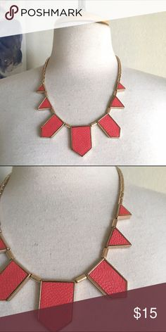 Statement necklace Very cute! It's a gold necklace. It has pink/red leather geometric pieces. It has an adjustable clasp. Boutique Jewelry Necklaces