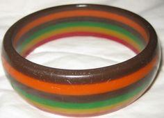 Very Rare Vintage Bakelite Six Layer Striped Multicolor Bangle Bracelet by familyjewelsatlanta on Etsy https://www.etsy.com/listing/207644901/very-rare-vintage-bakelite-six-layer