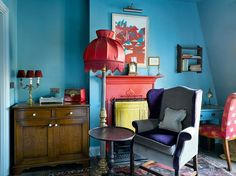 Zetter Townhouse: Blue walls, red and yellow fireplace, boudoir lampshade and super cool radio - love it.