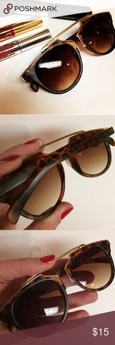 🐢Tortoiseshell Fashion Sunnies🐢 Brown tortoiseshell, gold brow bar and accents, matte finish, brown lenses (not mirrored, slightly ombré). Bought and never wore. No scratches, no case. Will ship securely in bubble and tissue wrappings. Super on trend. A must have for the fashionista in your life. Price is firm. Accessories Sunglasses