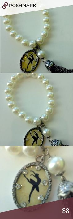 Ballerina Dancer Medallion Bracelet Faux Pearl Dainty stretch bracelet with faux pearls  • dancer ballerina Medallion with rhinestones surrounding  • Chain and string tassel suspended from silver bead Jewelry Bracelets