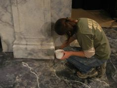 Scenic painter Lydia Borowicz uses a special painting technique, called marbling, to make the floor of the set resemble marble.