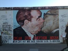 Get fraternal. Former Soviet leader Leonid Brezhnev is painted kissing his East German counterpart Erich Honecker (R) on a segment of the East Side Gallery, the largest remaining part of the former Berlin Wall in Berlin Street Art, East Side Gallery, Berlin Wall, Berlin Graffiti, Berlin Berlin, Berlin Germany, Free Things To Do, Cheap Things, Art Mural