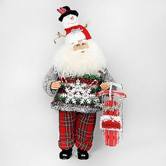 The Snowman Santa from Karen Didion Originals brings the joy of Christmas into your home. The quality of this figurine is unmatched with its hand-painted face, glass inset eyes, real mohair beard, unique fabric, and detailed accessories.