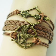 Unleash your inner Katniss with this Hunger Games-inspired bracelet, which comes with a mockingjay and bow & arrow. The rope chain and vintage bronze metals will complement your Boho chic looks are we