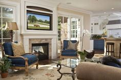 Fireplace flanked by French doors. Like the way the tv is mounted and framed