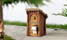 Miniature Garden Woodland Outhouse decor with crescent moon door detailing. The size of this Fairy Garden item is2.4x2.6x3.9 and it is made ofResin. Well HelloMy Fairy Gardens Friend!