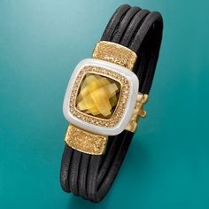Italian Mother-Of-Pearl and Leather Bracelet.  The bold, the beautiful: four black leather cords wrap around to a centerpiece of mother-of-pearl and hammered 18kt gold over sterling silver. Trimmed with a faceted yellow glass focal point and brown CZs. >>Click on the #leather #bracelet for more jewelry styles.