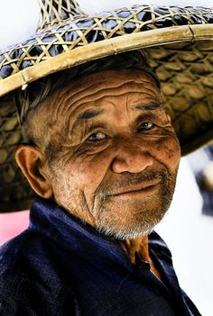 Chinese fisherman -- How did he get those blue eyes?