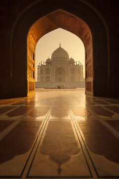 I love this photo do the Taj Mahal because it's not the typical photo you see of the Taj Mahal (Taj Mahal and it's reflection). I also love how the arch around the Taj Mahal immediately draws your eye to the building. Taj Mahal India, Places To Travel, Places To See, Wonderful Places, Beautiful Places, Beautiful Pictures, Places Around The World, Around The Worlds, Islamic Architecture