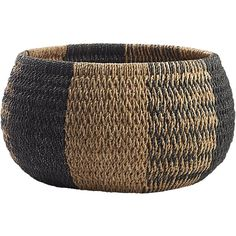Shop cobra basket.   Using traditional methods, skilled artisans hand-weave sustainable sea grass in a striped collage of solid and patterned bands.  Sturdy wire frame construction is upsized to store linens, towels, toys.