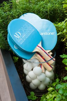 Sponsor Caesarstone provided stone surfaces for the bars—as well as a custom ping-pong table. Bright blue paddles featured the company's logo as well as the event's logo.  Photo: Michele Eve Photography for BizBash