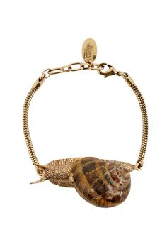 Delving into Vivienne Westwood's jewellery archive, this Spring/Summer 2014 the Snail collection makes a return from the Spring/Summer 2002 Nymphs collection. Quintessentially English, the Snail Necklace, delicately produced from a real snail shell, beautifully creates the suggestion of back gardens after the summer rain.