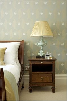 A bedroom with walls in Rosslyn BP 1938 and trim in Shaded White Estate Eggshell.An inspirational image from Farrow and Ball