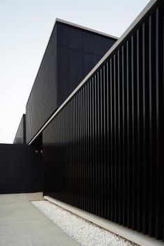 Black facade. Shelter Home for the Homeless by Javier Larraz.