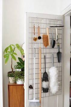 How to utilize some extra storage space by adding hidden door storage in the form of a hanging rack.