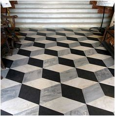 Marble flooring in 3-D cube pattern.