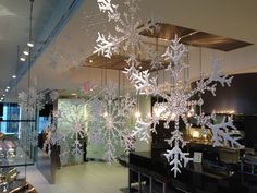 Hang different sized snowflakes with fishing line for a winter wonderland theme.