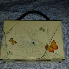 Vtg butterflies & spiderwebs Cigar Box Purse This bag was painted by Mary Merton of The 3 Hills. This bag is #101 of 101 bags. No two are a like. Mary only sold to local boutiques. I purchased this bag an several others at her estate auction and have used them for several years. There is a dated penny and mirror in the bag and a leather strap gold toned hinges and feet are on the box. The box measures 10.5x 7.25 x3. It is a show stopper. It was made in 1969. Vintage Bags Clutches & Wristlets