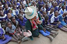 U.S singer Madonna, center, poses for a picture with children in Kasungu, about 150 kilometers north of the capital Lilongwe, Sunday, Nov. 30, 2014. Madonna is currently visiting Malawi with her son David and daughter Mercy, where she has been working since 2006 with her non profit organization, Raising Malawi. (AP Photo/Tsvangirayi Mukwazhi)