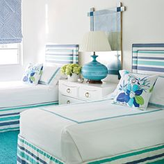 Palm Beach Guest Bedroom | Twin beds decked out in turquoise and indigo-blue pop against crisp white walls in designer Meg Braff's West Palm Beach bedroom.