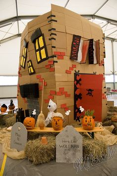 Maybe if I start saving diaper boxes now I will have enough to make this haunted house by Halloween.