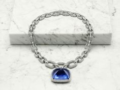 BVLGARI Burmese sapphire necklace - 180-carat cabochon-cut Burmese sapphire, step-cut and pavé-set white diamonds with a total weight of 28.46 carats, platinum.