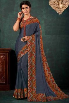 Dark Grey chiffon saree with multi color chiffon blouse. Embellished with embroidery. Saree with V Neck, Half Sleeve. It comes with unstitched blouse. Saree Blouse, Sari, Dark Grey Color, Chiffon Saree, Traditional Sarees, Blouse Online, Saree Collection, Fabric Material, Designer Wear