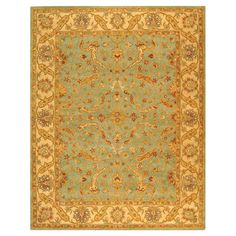 Hand-tufted wool rug with a Persian-inspired motif.   Product: RugConstruction Material: WoolColor: ...